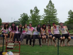 Holi participants from last year, covered in colored powder and water from water balloons. Photo Courtesy of Deval Patel