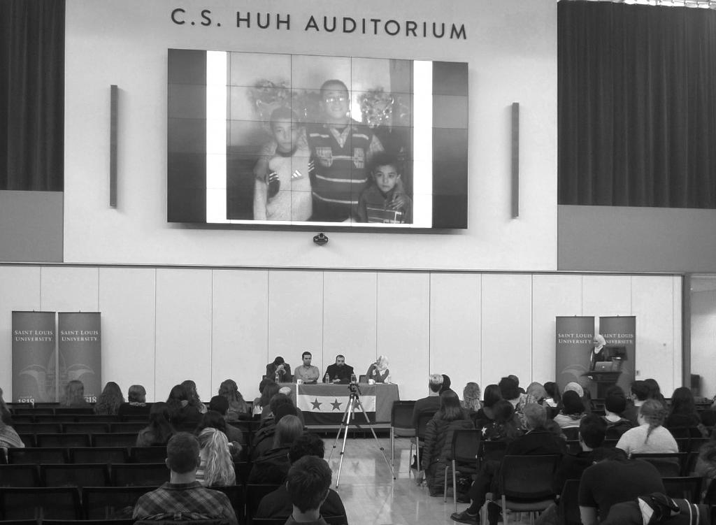 Voices: Panelists share survival stories from massacre. Photo by Adnan Syed.