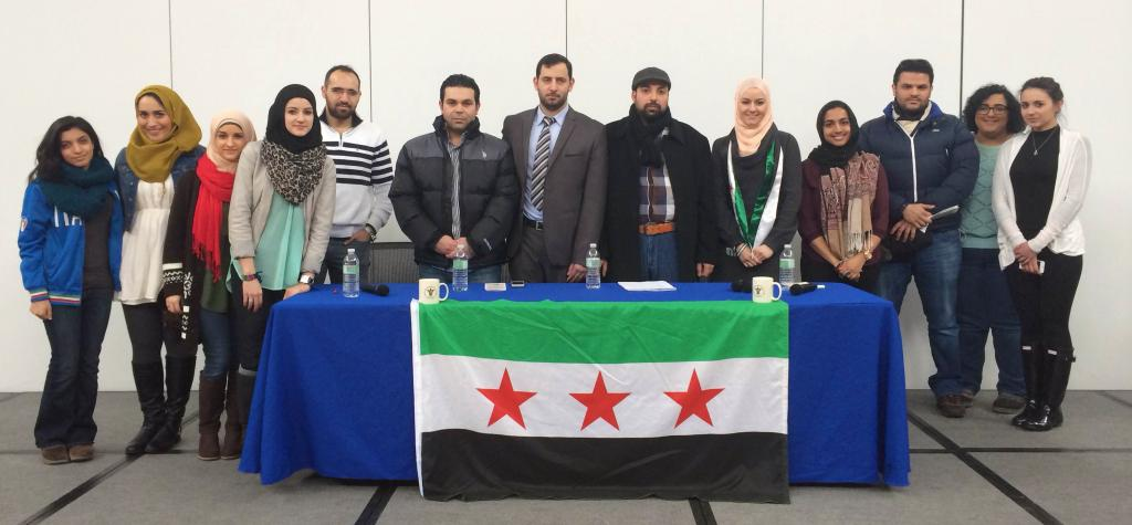 """The panel: Audience members with panelists from the """"Voices from Syria"""" event."""