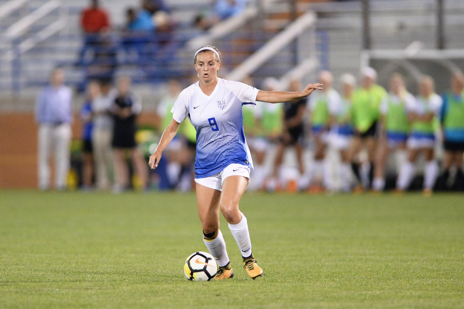 Senior midfielder Lauren Tondl gets ready to pass the ball to a teammate.