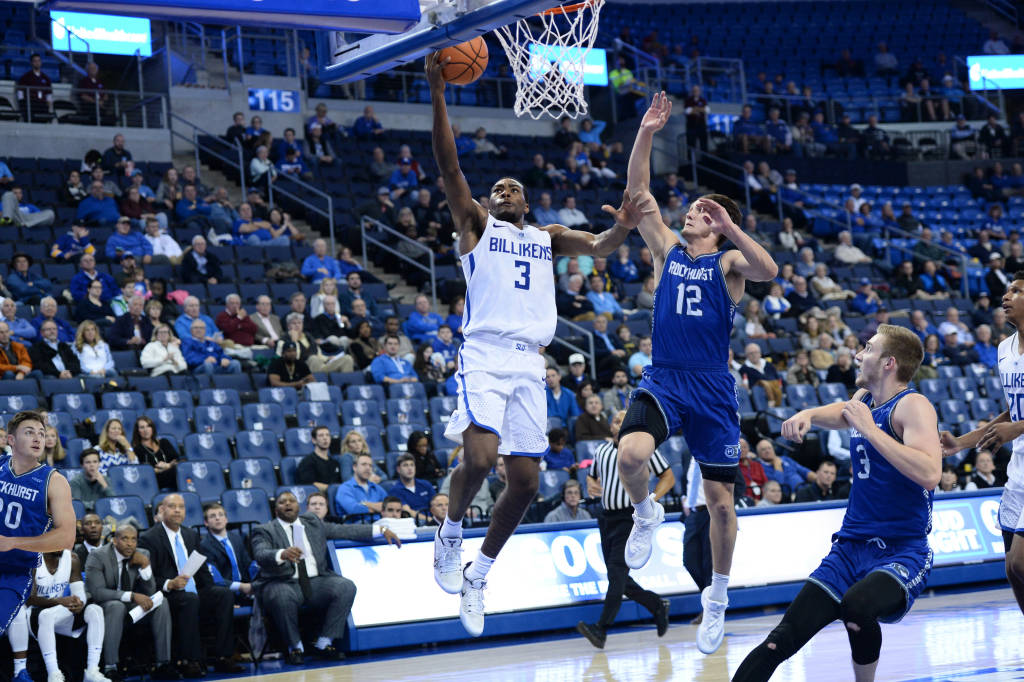 Redshirt junior guard Javon Bess jumps above a defender in the game against Rockhurst. Bess scored 15 points against LaSalle.
