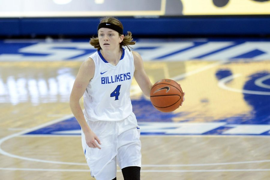 Redshirt+junior+Keri+McMahan+pushes+down+the+court+on+a+fast+break.+McMahan+hit+the+game-wining+free+throw+against+UMass+with+one+second+left.