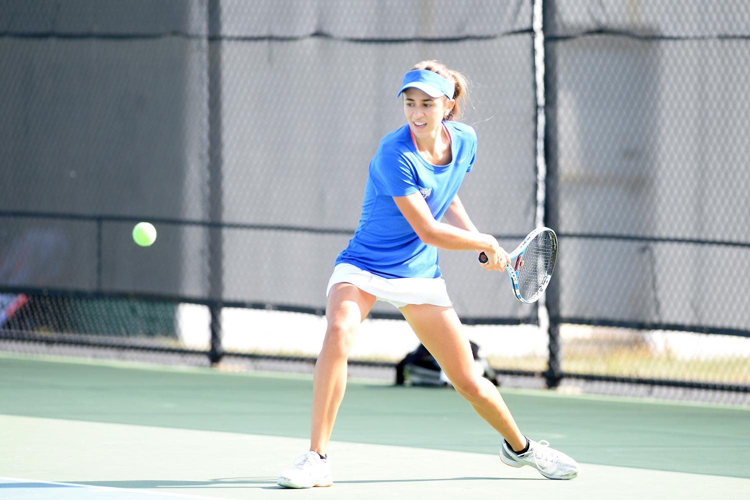 Sophomore Mariluz Rojo stares down the ball before hitting forehand.