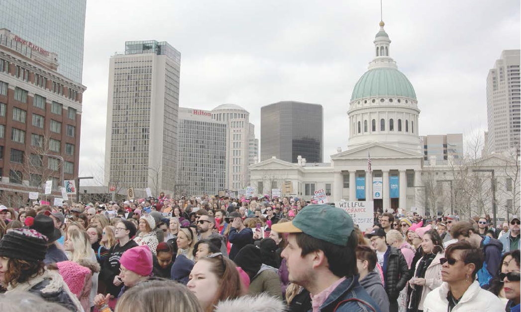 Listening to speakers, women and their allies stand in solidarity. The St. Louis Women's March began at 10 a.m. and drew a sizeable crowd of people with varying colors, ideologies and backgrounds. They listened together. They marched together. They continue to look to a better future together.