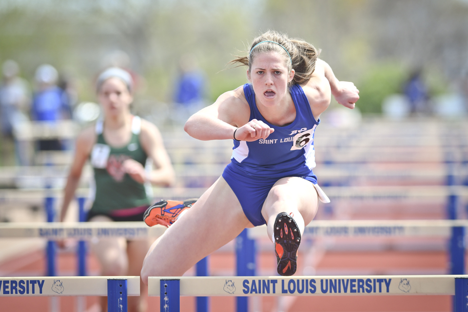 Sophomore Amanda Baker powers over a hurdle. Baker broke the pentathlon record at the Thundering Herd Invitational.