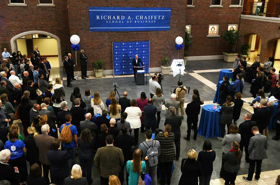 Students, staff and faculty gather in the newly renamed Richard A. Chaifetz School of Business to listen to Dr. Chaifetz speak about his relationship with the University.
