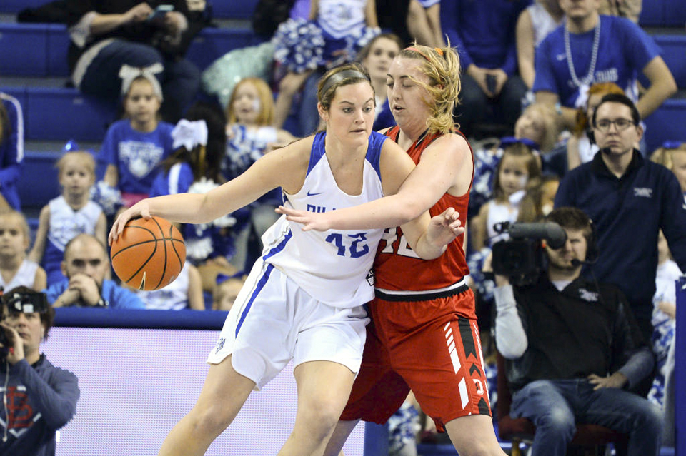 Senior Maddison Gits evades a Davidson defender. Gits scored 34 points and grabbed 15 rebounds in the double-overtime win against Fordham.