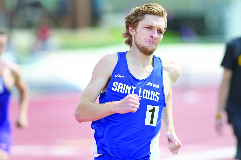 Senior Ryan Noonan races around the track. Noonan took home three medals at the Atlantic-10 Indoor Championships.