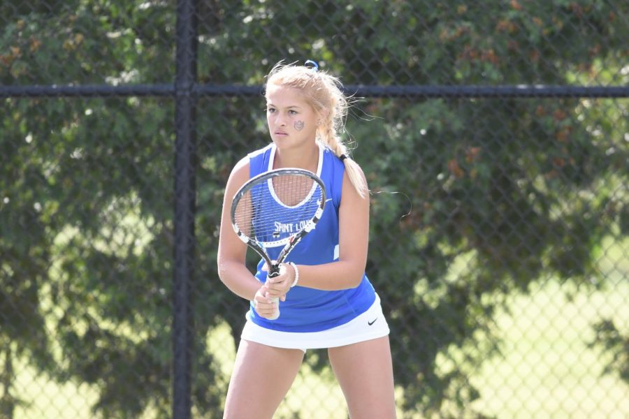 Sophomore+Cassie+McKenzie+awaits+the+serve.+McKenzie+posted+wins+in+all+of+her+conference+matches+last+week.