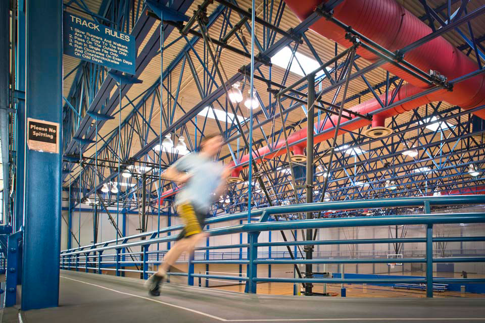 A SLU student runs laps on the indoor track in Simon Recreation Center.