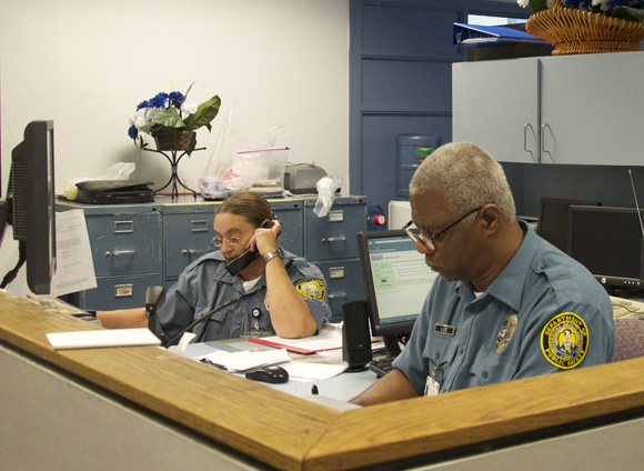 Communication officers Terrance Lee (Right) and Christine Crider (Left), will benefit from the new DPSSS technology.   Candra Johnson / Staff Photographer