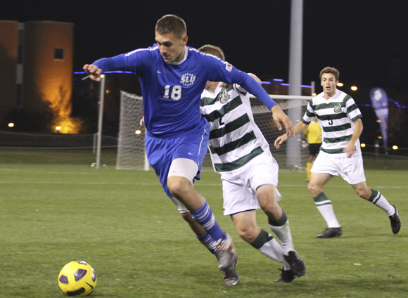 Freshman Robbie Kristo (18) evades a Charlotte defender in Saturday night's action.  Curtis Wang / Multimedia Director
