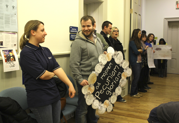 Students and faculty from the department of Public Policy and Counseling and Family Therapy participate in a demonstration outside the board of trustees meeting on Friday, Feb. 10 in Verhaegan Hall
