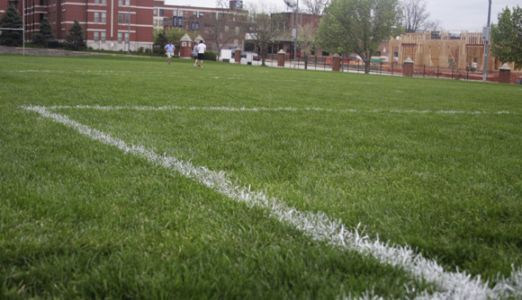 The grass fields located on the corner of Vandeventer Ave. and Laclede St. will be replaced with artificial turf. The field is frequently used for intramural sports. Jennifer Wang/ Photo Editor