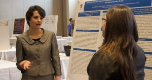 Michael DiMaria / Staff Writer Katie Eschbacher gave her presentation on literature-driven reviews at the 2013 Senior Symposium.