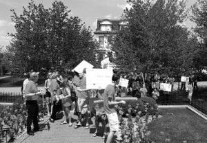Kristen Miano / Editor in Chief Roughly 50 protestors marched to Cartier Hall on May 1, calling for the removal of Father Biondi.