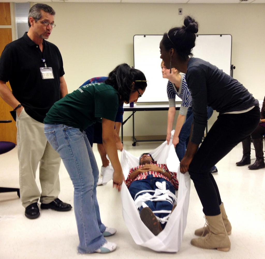 Hands-on learning: Students participate in a first aid demonstration during last year's conference. Photo courtesy of Alpha Epsilon Delta.