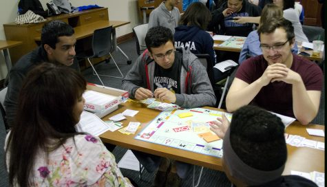 Oppression Monopoly: Students play Monopoly with a twist as part of Oath Week. Wolf Howard / Photo Editor