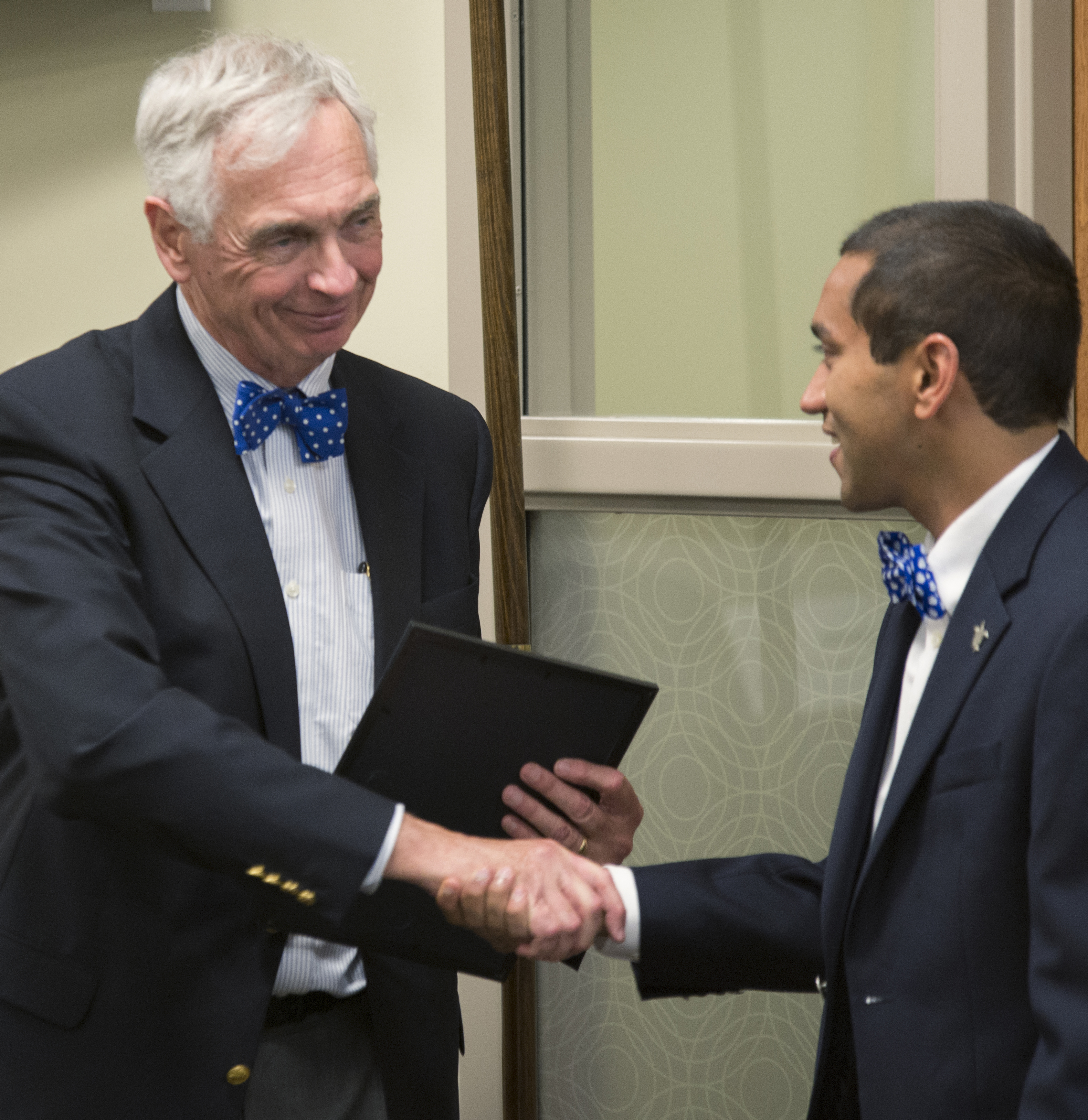 An honorable farewell: Interim President Bill Kauffman receiving his award from SGA on Wednesday. John Schuler / Photo Editor
