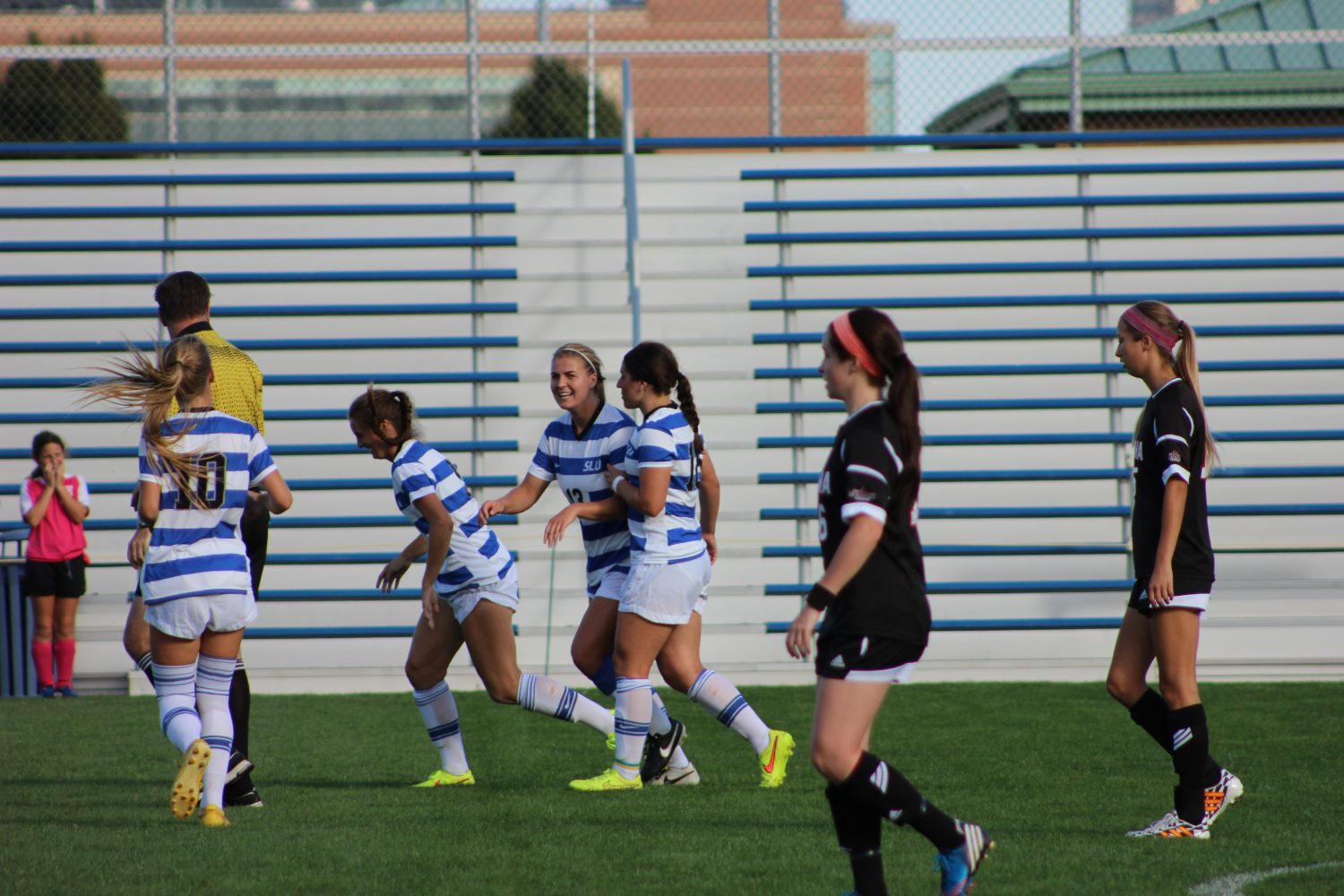 Celebrate%3A+The+women%E2%80%99s+soccer+team+celebrates+one+of+four+goals+in+a+game+against+UNO.+The+Billikens+scored+two+goals+in+each+half+of+the+contest.%0AEmma+Kelly+%2F+Staff+Photographer