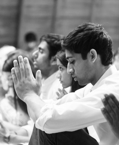 Worshipping together: A SLU student prays during the Divali celebration in DuBorg Hall. Ryan Quinn / Photo Editor
