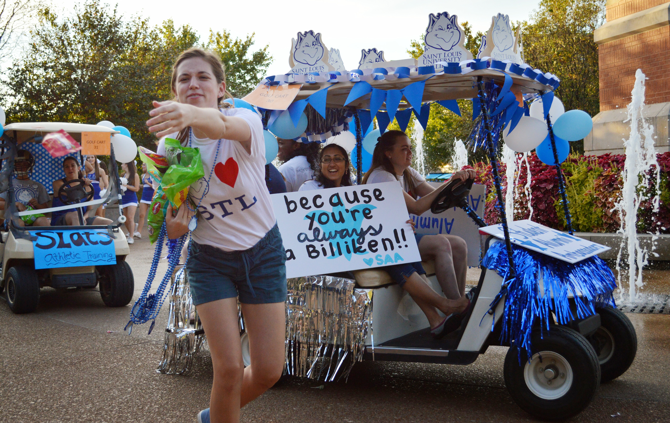 Homecoming: SLU students, alumni, and family participate in the golf-cart parade, one of the many activities held during the weekend. Elizabeth Scofidio  / Contributor