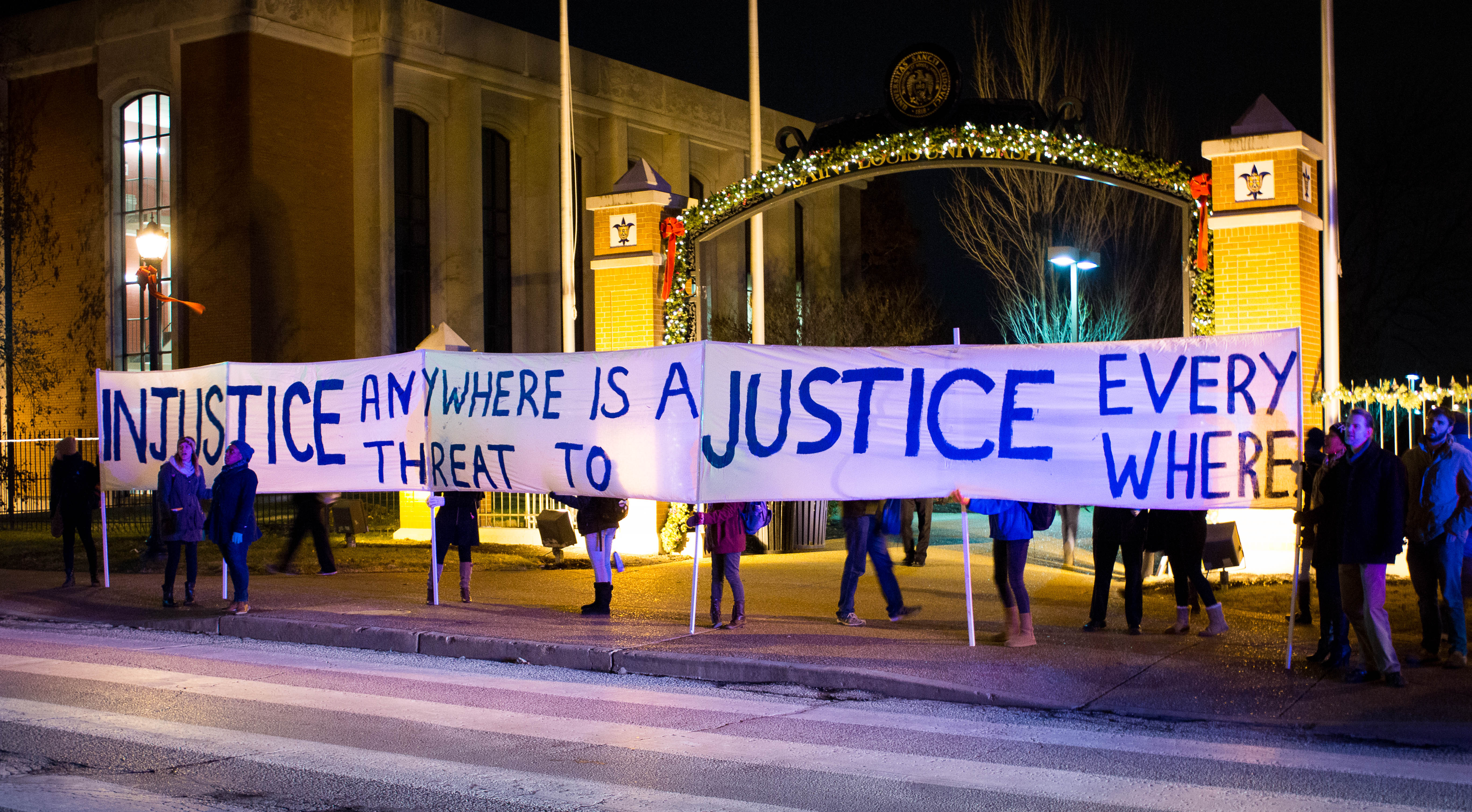 Taking it to the streets: Protesters demonstrated along Grand Ave. the night of Monday, Nov. 24.  Javier Muro de Nadal / Staff Photographer