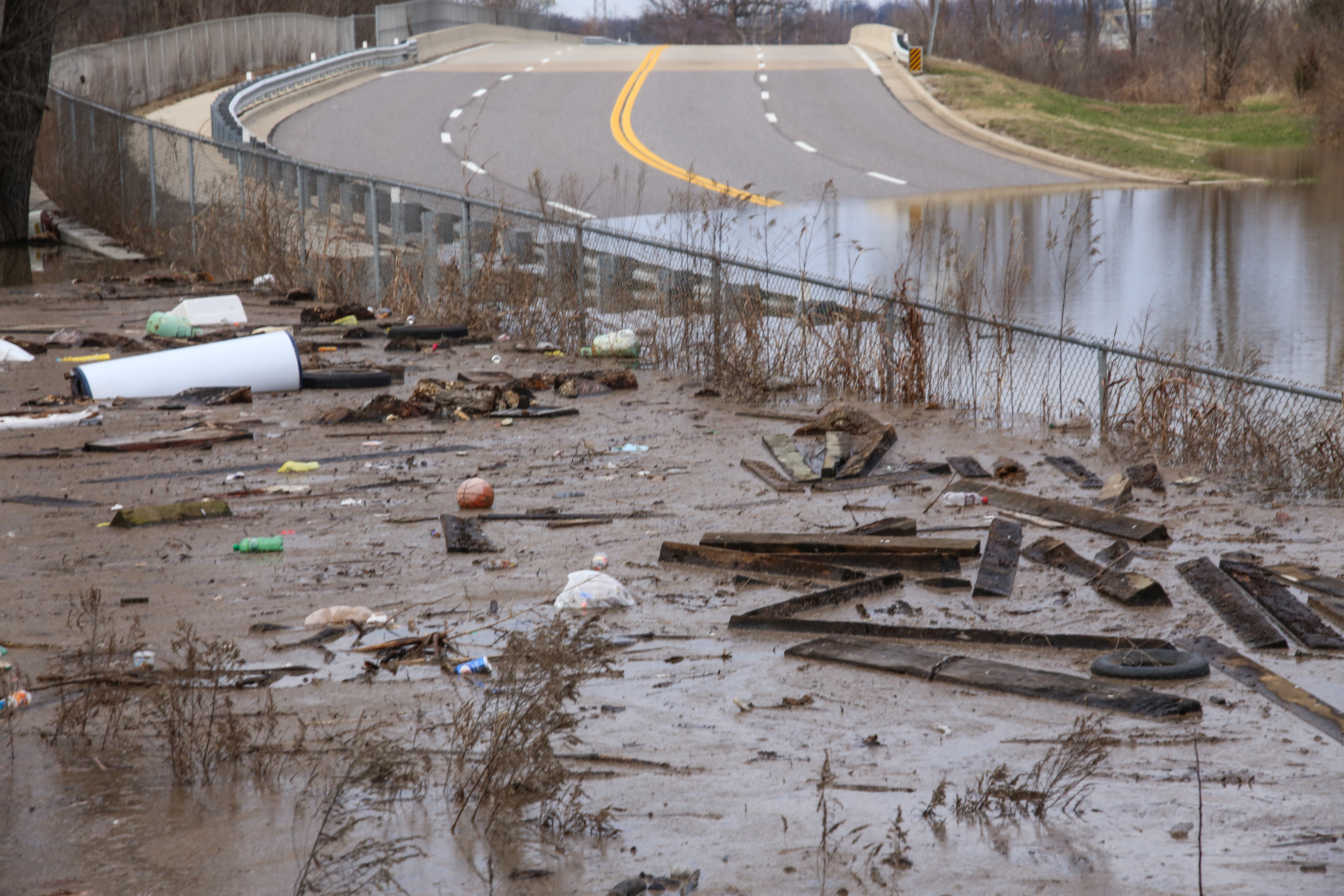 INUNDATED: Rising water levels encroached on a stretch of road near River Des Peres. Last month's floods halted highways and damaged numerous homes in the area.