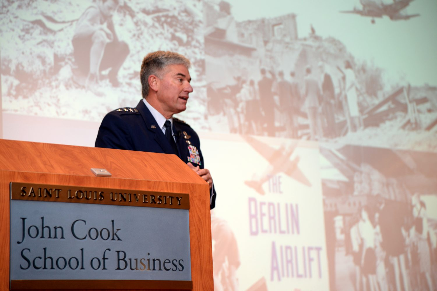 Lt.+Gen.+Sam+Cox%2C+18th+Air+Force+commander%2C+talks+about+the+Berlin+Airlift+%22Candy+Bomber%22+and+his+role+in+bringing+hope+to+the+people+of+Berlin+as+part+of+his+lecture+at+the+Dean%27s+Breakfast+at+Saint+Louis+University+in+St.+Louis%2C+Missouri%2C+Nov.+10.+Cox+addressed+about+50+business+leaders+and+John+Cook+School+of+Business+alumni+during+the+lecture+and+question-and-answer+session%2C+addressing+topics+such+as+the+role+18th+Air+Force+plays+in+providing+rapid+global+mobility+to+deployed+forces+and+explaining+how+the+services+work+together+to+move+personnel+and+cargo+throughout+the+world.+%28U.S.+Air+Force+photo+by+Master+Sgt.+Thomas+J.+Doscher%29