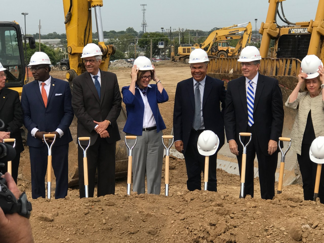 Hospital+stakeholders+celebrate+the+construction+with+ceremonial+scoops+of+dirt.