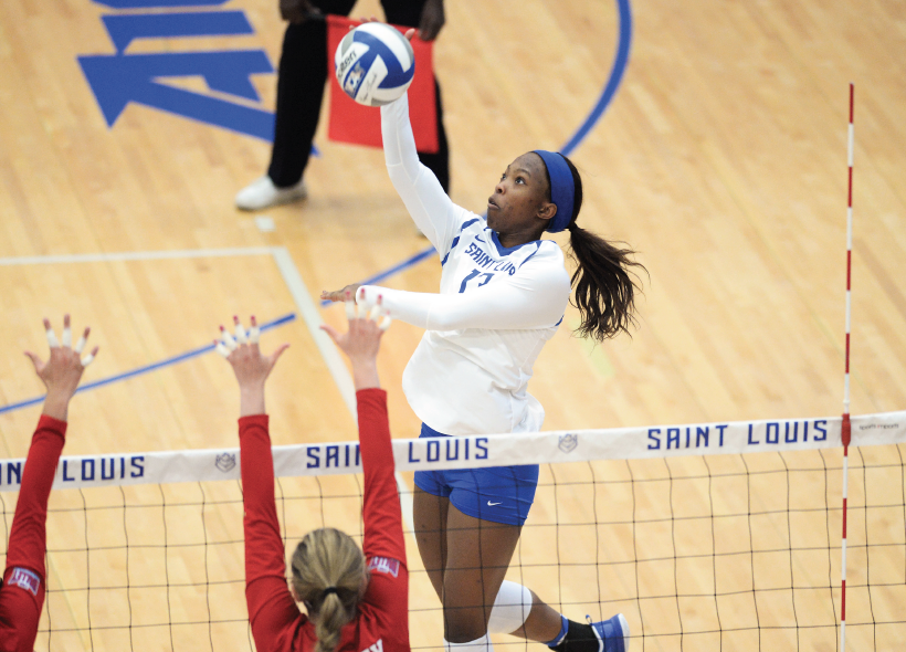 Senior outside hitter Nenye Okoro sends the ball over the net against Bradley. Volleyball won this exhbition game 3-1, before going 0-6 in their first six games.