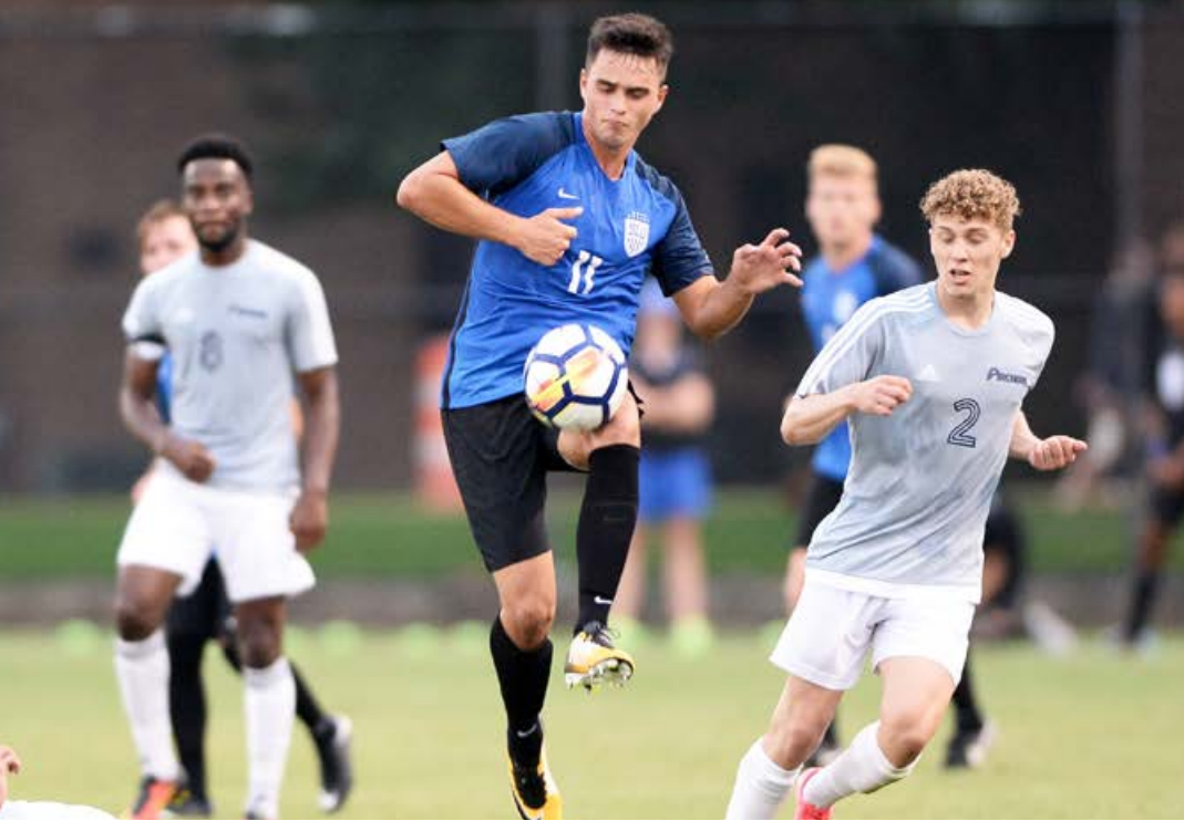 Sophomore forward Leo Novaes moves the ball around defenders. Novaes scored the game-winner at George Mason Saturday, Oct. 14.