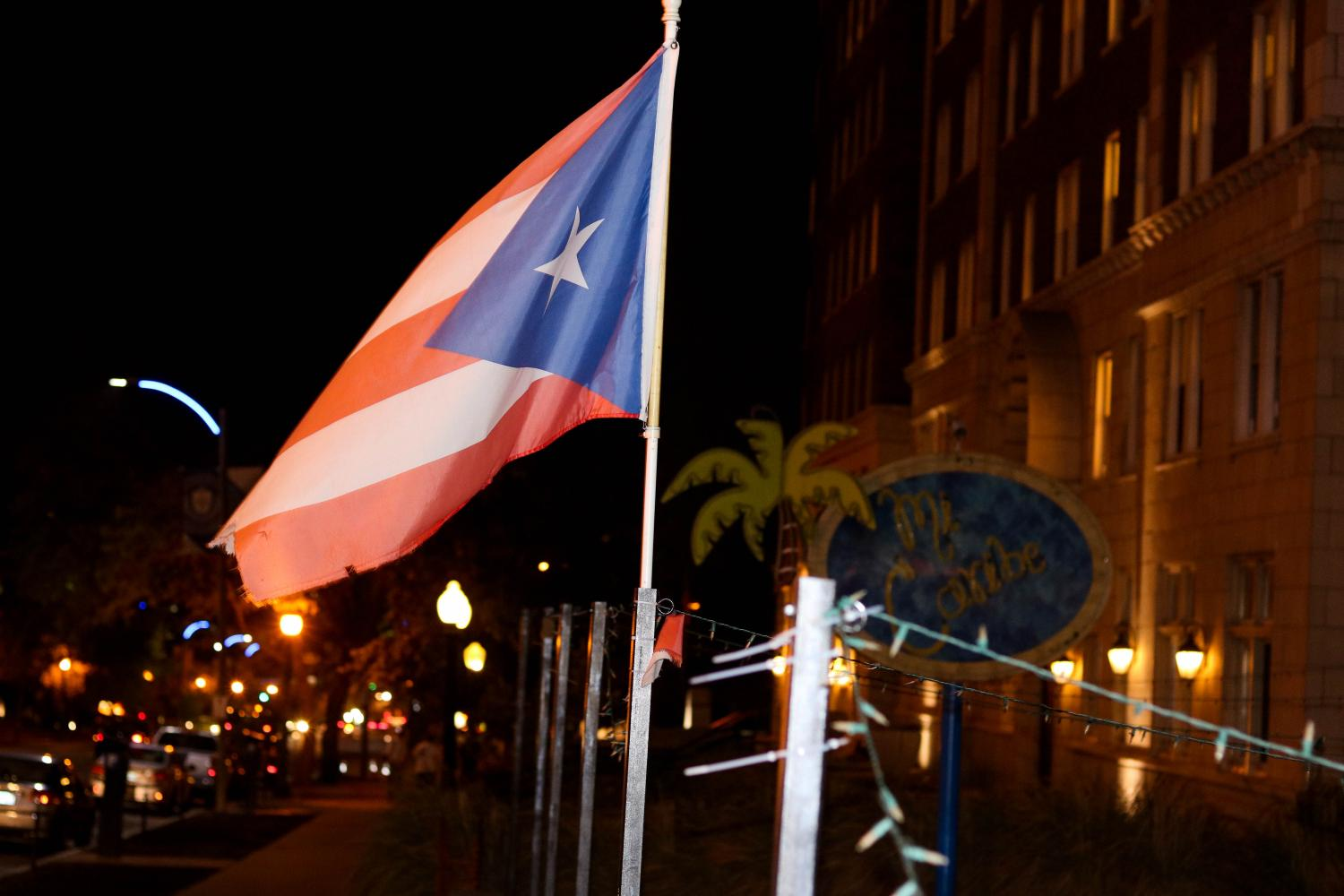 A Puerto Rico flag flies outside of Mi Caribe, where a fundraiser for the island took place.