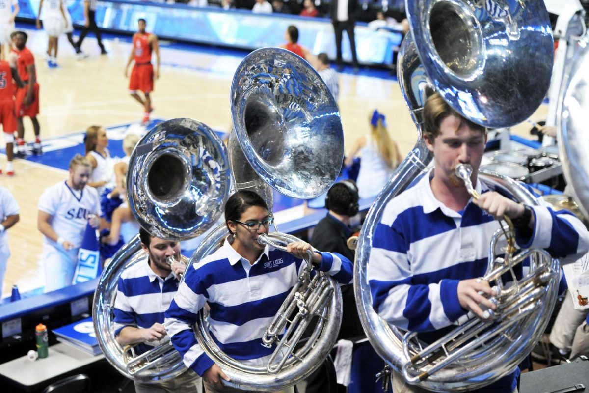 The pep band works hard during basketball games to keep the crowd engaged.