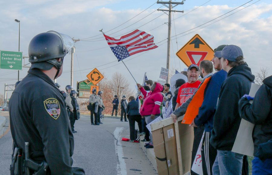 Police officers lined the street, separating pro and anti-Trump parties.