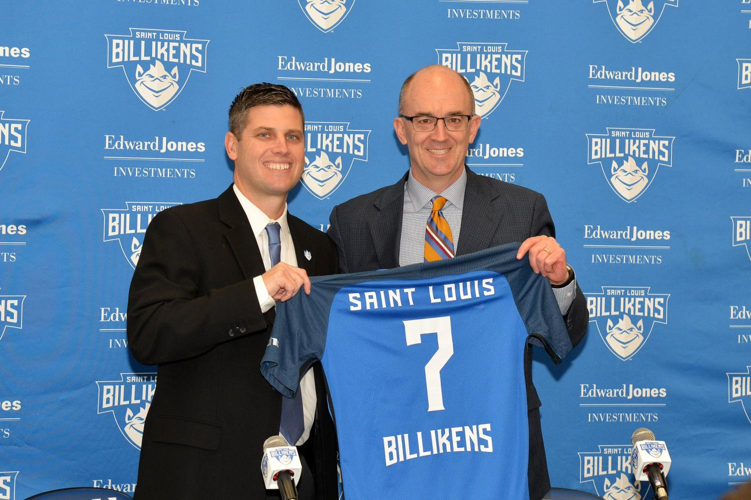 SLU Director of Athletics Chris May (right) presents new SLU Men's Soccer Head Coach Kevin Kalish with a jersey. Kalish was introduced to the media on Mon., Jan. 22.