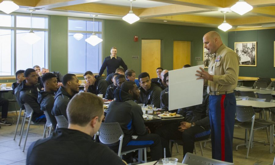 Marine Corps Major Ryan B. Cohen talks to the men's basketball team about working as a team and applying leadership skills on and off the court.