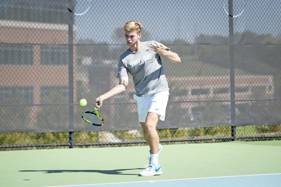 Sophomore+Justin+Nogalski+backhands+the+ball+over+the+net.+Nogalski+posted+a+win+at+Arkansas.