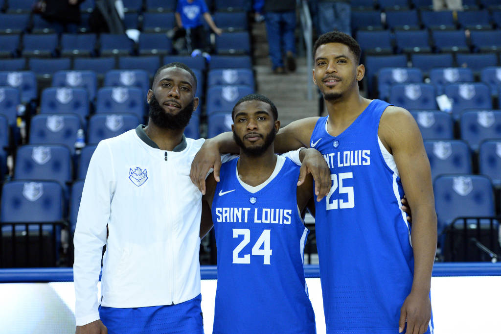 Seniors Davell Roby, Aaron Hines, and Rashed Anthony pose for a group picture after the senior day festivities at Chaifetz Arena.