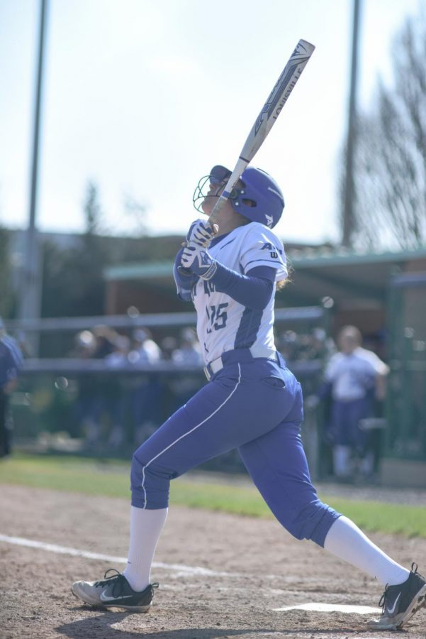 Freshman+outfielder+Sadie+Wise+watches+a+fly+ball+leave+the+bat+against+SIU.