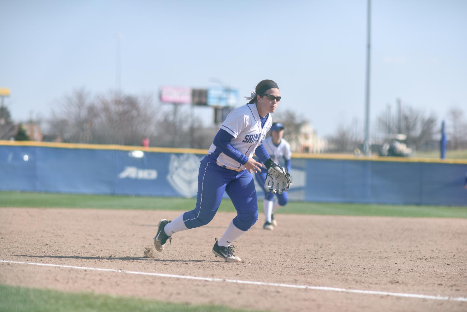 Senior infielder Allie Macfarlane fields a ground ball against SIU. She hit her fifth career grand slam at the Rock Chalk Challenge.