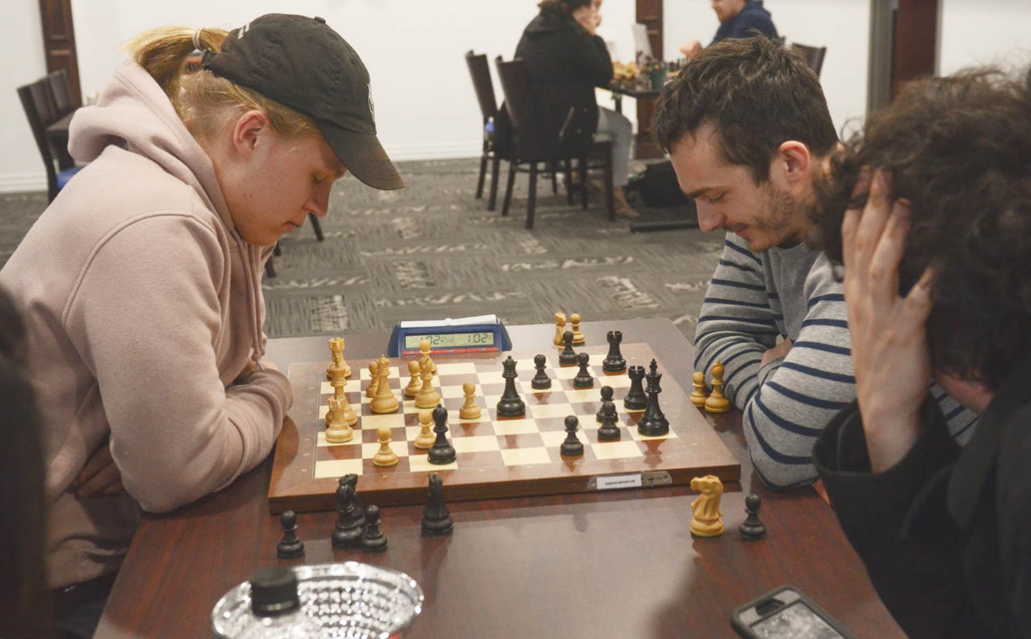Concentration: SLU Chess coach Alejandro Ramirez looks on in a game of chess during Atlas Week. SLU Chess has placed twice in the President's Cup Tournament.