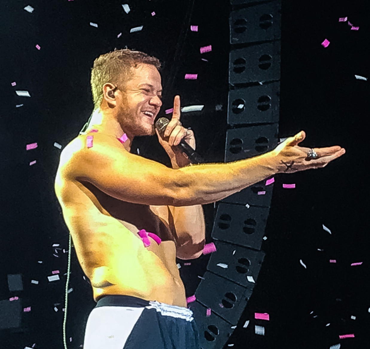 Imagine Dragons singer Dan Reynolds sings to the crowd in a sea of confetti at the Hollywood Casino Amphitheater.