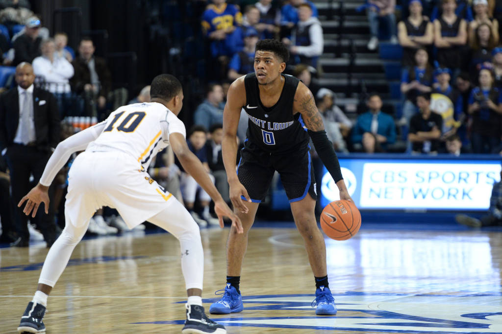 With just three games remaining in regular season conference play, the Men's Basketball team has the opportunity to move up in the standings playing three teams that rank higher them in the conference standings.  Photo Courtesy of Billiken Athletics.