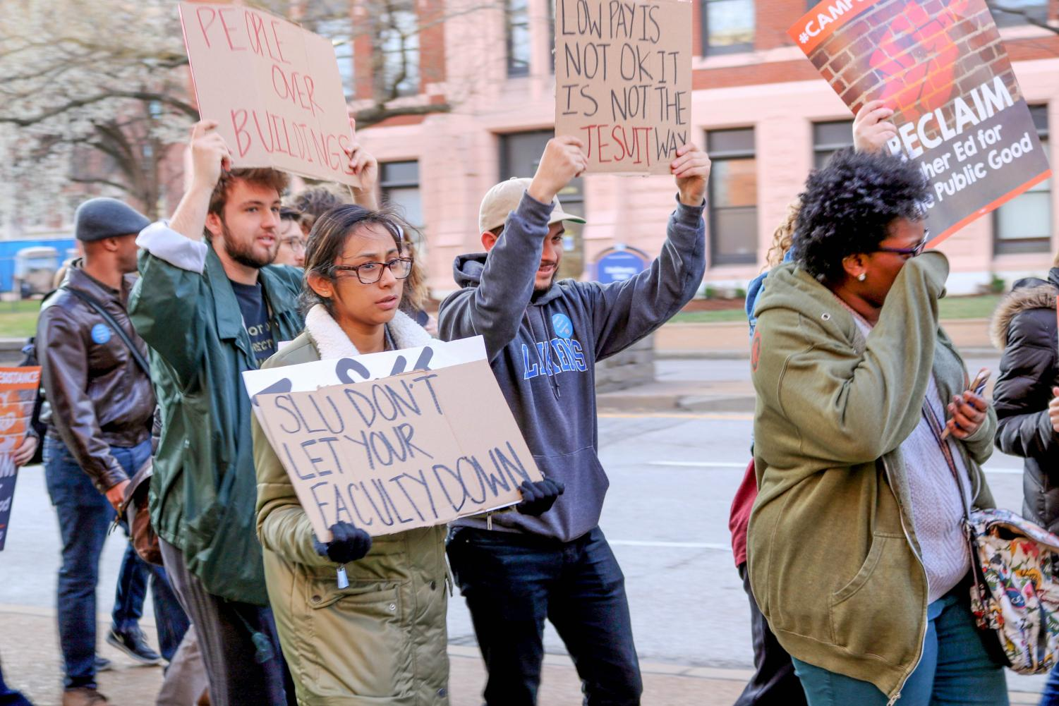 SLU community marched for adjunct professors in spring 2017 with many of the same grievances as discussed in the SavingSLU movement. (Emma Carmody / The University News)