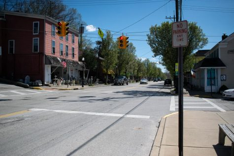 The streets were practically barren. Some cars continued to pass through, but the sidewalks were sparsely used.