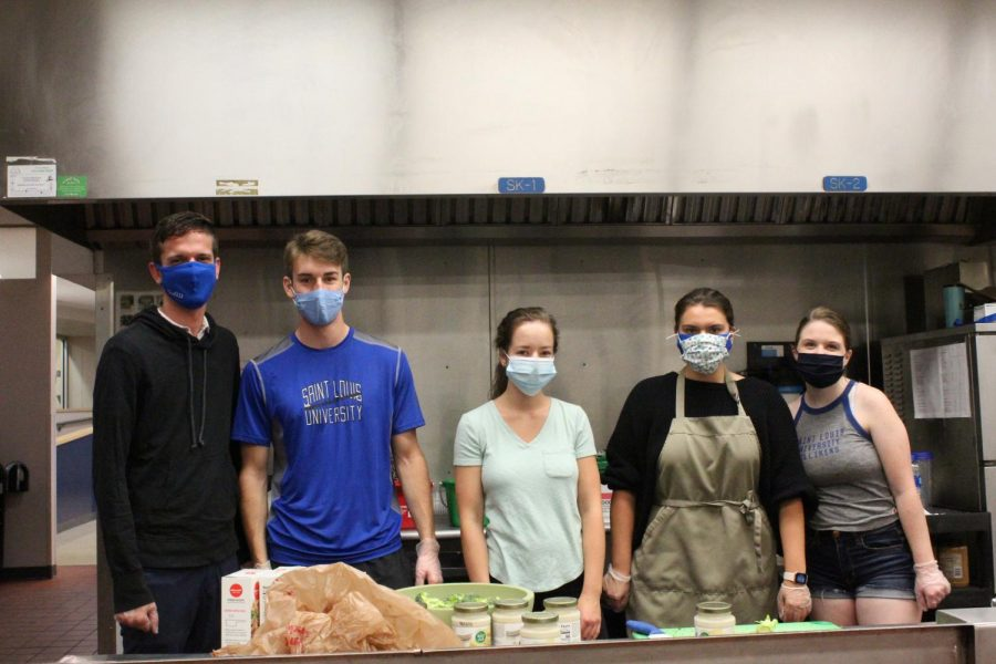 Patrick Horst, Dawson Myers, Claire Bartusch, Valerie Graham, Julia Duncan pose for a group photo while cooking in Reinert Hall.